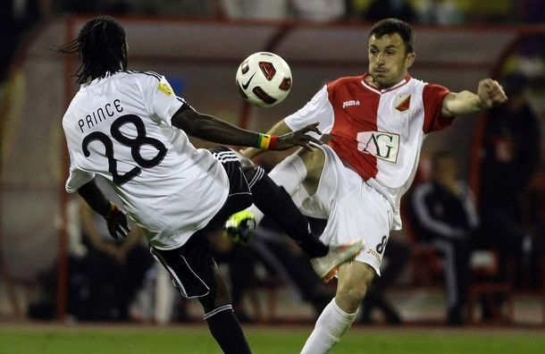 Partizan Belgrade's Tagoe challenges Vojvodina's Tumbasevic during their Serbian Cup final soccer match in Belgrade