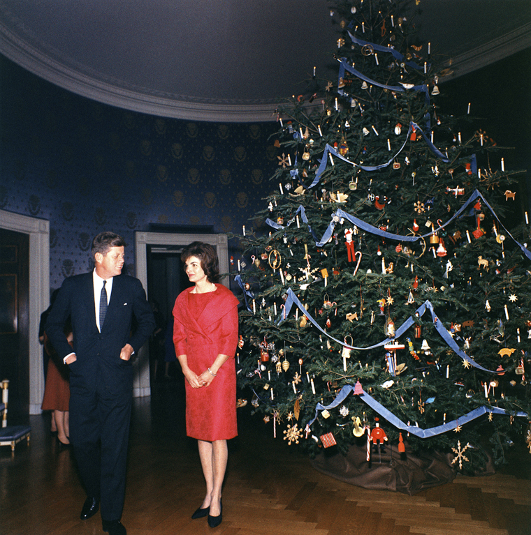 KN-C19677  13 December 1961 President and Mrs. Kennedy with the 1961 White House Christmas Tree. White House, Blue Room.  Photograph by Robert Knudsen, Office of the Naval Aide to the President, in the John F. Kennedy Presidential Library and Museum, Boston.